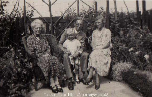 1935 George, Winifred and Christine Whitehead seated in Grandmother Whiteheads garden.