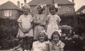 Christine with some friends at a 1935 birthday party.