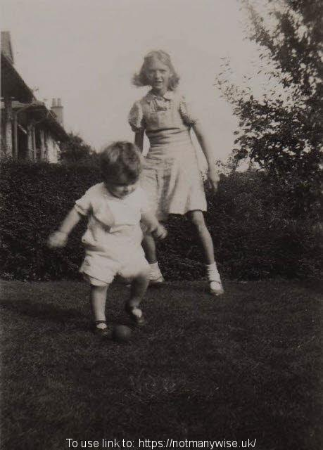 Christine Whitehead with Andrew Brown playing football in 1943.