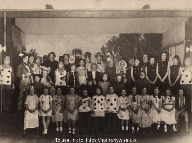 1946 Alice in Wonderland Christine as the White Rabbit on the back row.