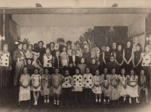 1946 The cast of Alice in Wonderland - Christine as the White Rabbit.