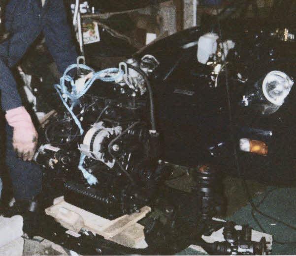 1989 Midas Kit Car being assembled in a garage.