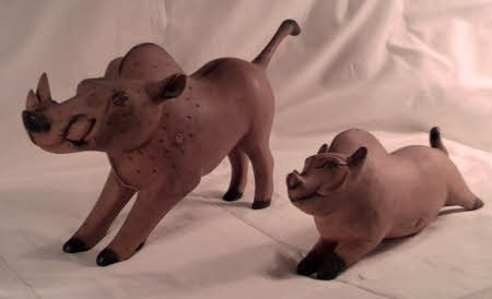 Souvenirs from East Africa, two wooden warthogs.