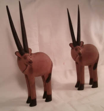 Two Oryx antelope looking to the side, souvenirs from Tanganyika.