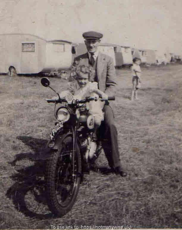George Reason on an old motorbike at a caravan site in the 1950's.
