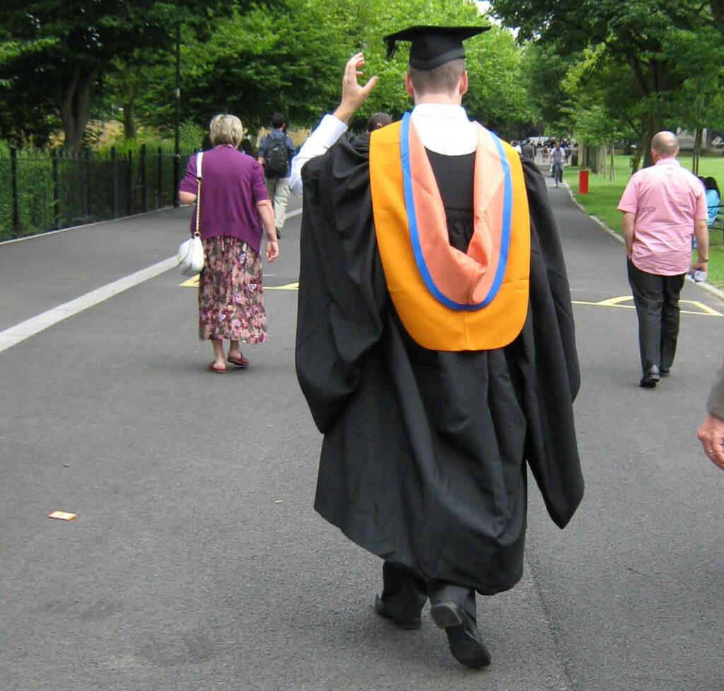 Graduation day a graduate walking down a street.