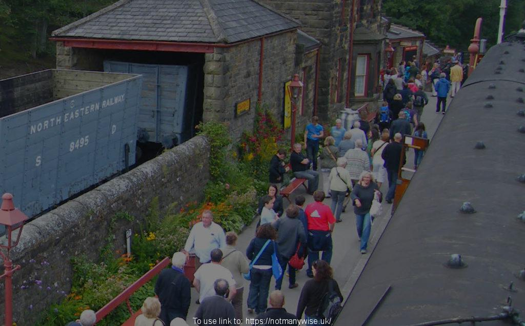 People on the North Yorkshire Moors Railway platform.