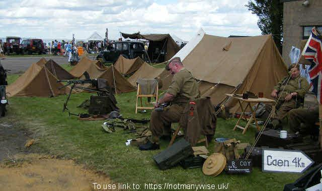 Ramsey 1940's weekend with British soldiers relaxing by there tents and weapons.