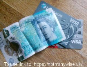 A £5 note and two credit cards