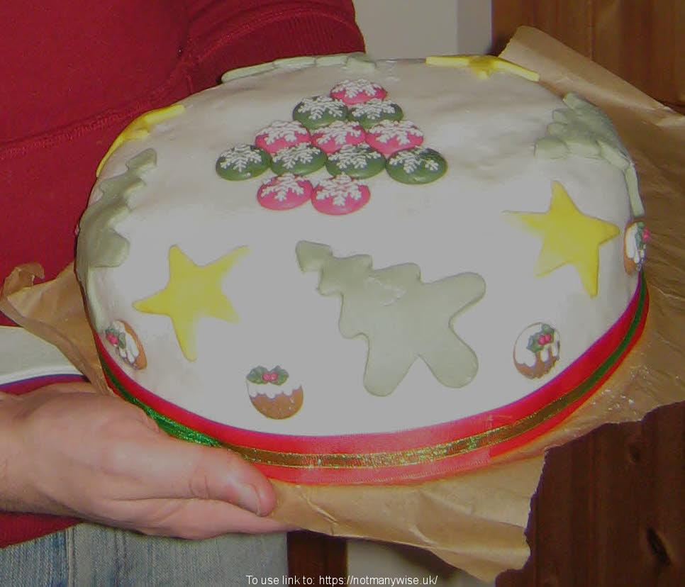 An amazing iced cake, decorated for Christmas.