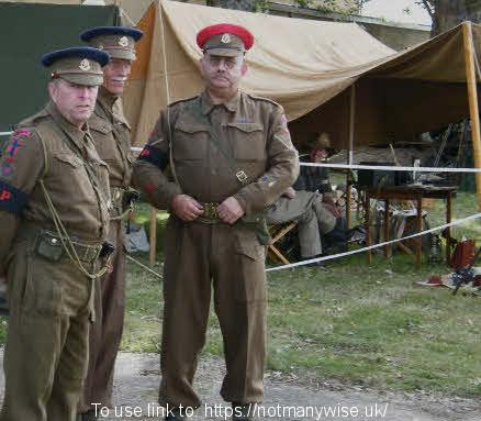 Three WW2 Military Police officers from the British army.