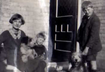 A young John Wales with some family and dogs.