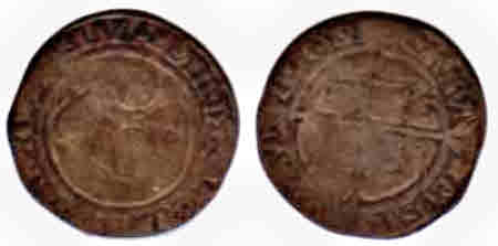 A very worn Elizabethan shilling showing both sides.