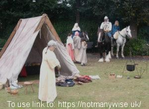 Medieval camp and horseman.