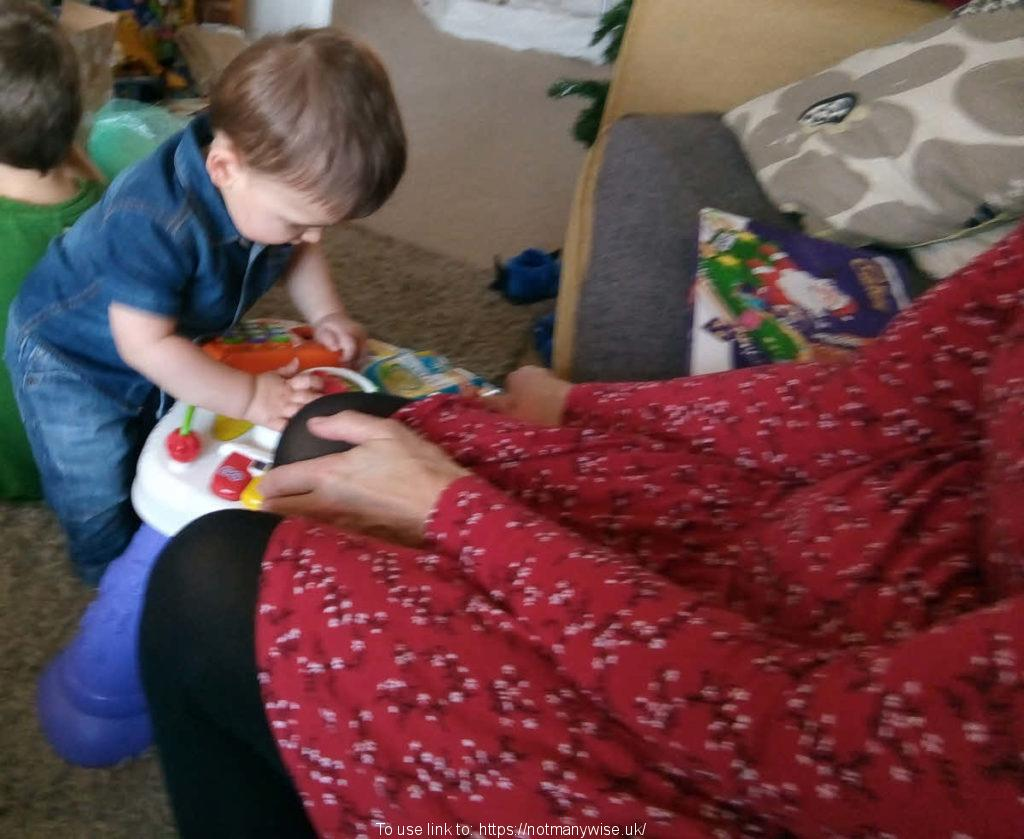 Granny or Nanny and grandson playing.