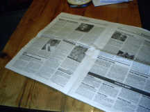 An open newspaper on a table