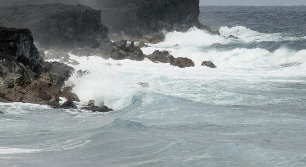 Large storm waves crashing against the rocks