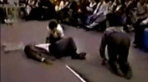 People laid out or crawling on floor from Toronto Blessing.